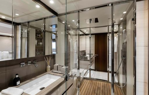 jacozami yacht with glass shower and grey toned sink