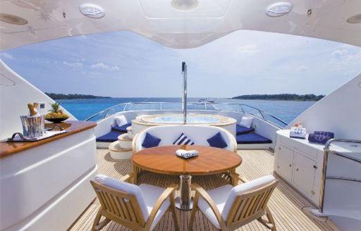 bar, table and Jacuzzi on the sundeck of motor yacht SEABLUE'Z