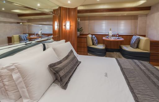 Owner's suite on luxury charter yacht ALMAZ, with private lounging area in background