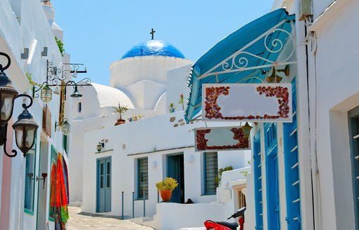 white homes and blue-roofed churches in pretty Sifnos town