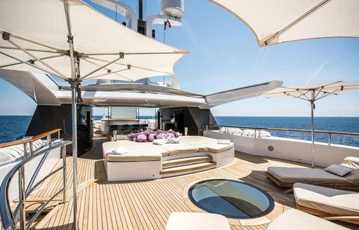benetti motor yacht st david sun deck with sun pads and umbrellas