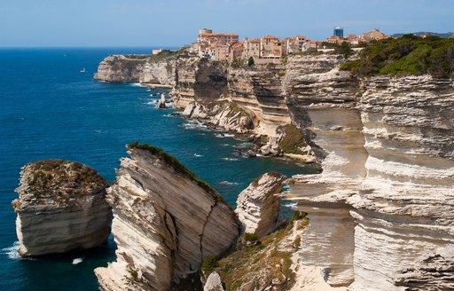 the limestone cliffs and blue waters of Bonifacio, Corsica