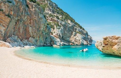 White sandy beach in cove in Sardinia