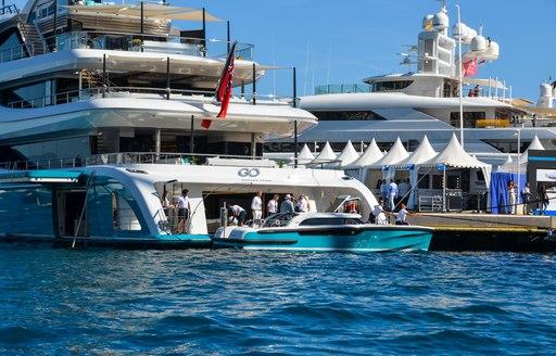 superyacht go with tender garage at monaco yacht show
