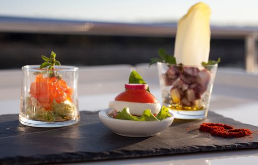selection of delicious dishes served on superyacht