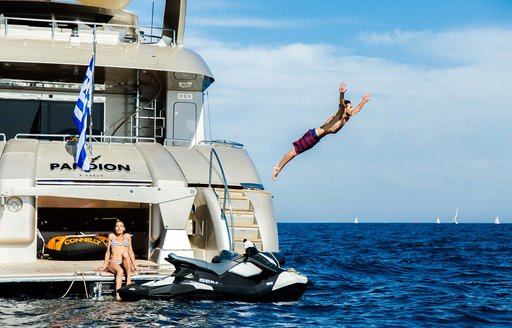charterers enjoying the sunny weather and the privacy of they luxury superyacht during the coronoavirus outbreak where they will not contract it because they are far away from high risk areas