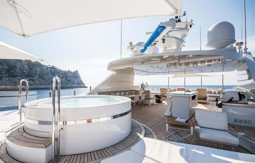 Jacuzzi on deck of superyacht ARBEMA with shade overhead