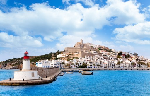the charming Ibiza Town seen from the azure waters