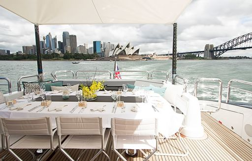 skyline of Sydney is seen from aft deck of luxury yacht QUANTUM