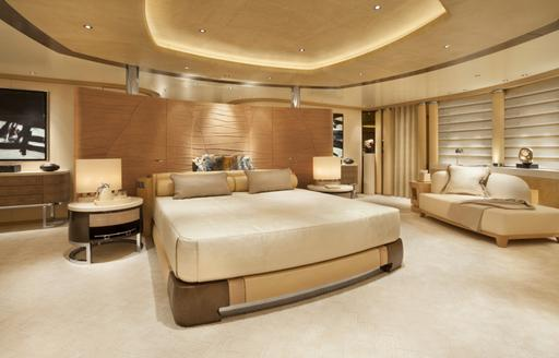 large bed in the master suite with panoramic views aboard charter yacht GRACE