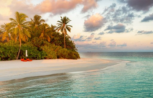 tropical island, perfect for visiting on yacht charter