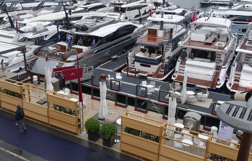 Yachts lined up along the harbour at Monaco Yacht Show 2019