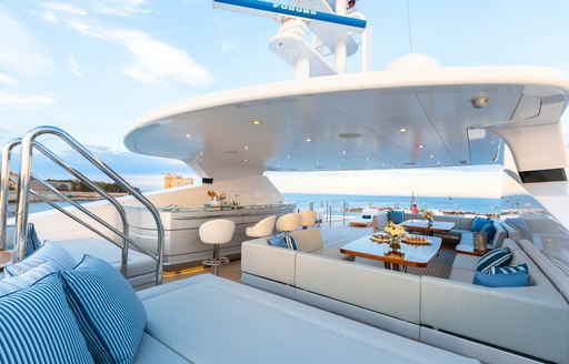 seating area and bar on the sundeck of a superyacht