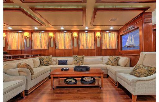 sofa and armchair in main salon of luxury gulet Sea Dream