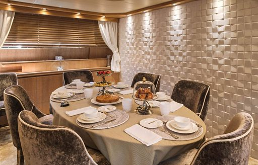 Formal dining area on luxury yacht AMAYA