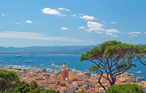View of St Tropez and charter yachts anchored in the bay