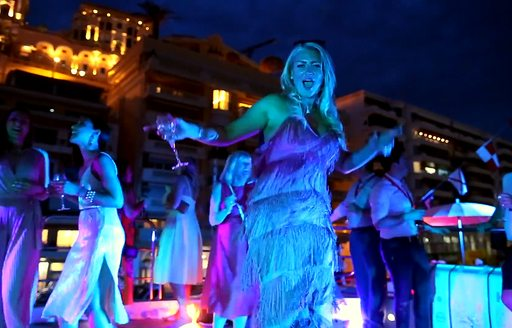 woman dancing on yacht during monaco grand prix after party
