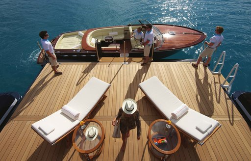 aerial shot of superyacht guests arriving to charter yacht