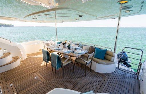 aft deck dining arrangement on luxury yacht chess
