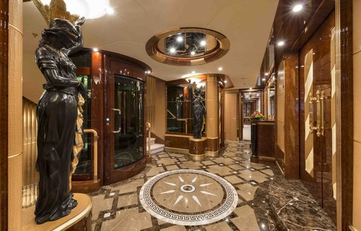 A statue and ornate flooring featured on board superyacht 'Mine Games'