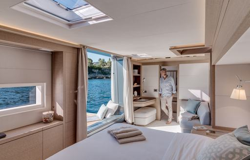 Master suite with light streaming in aboard luxury charter catamaran Double Down