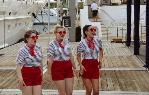 women in sailor suits dancing at flibs