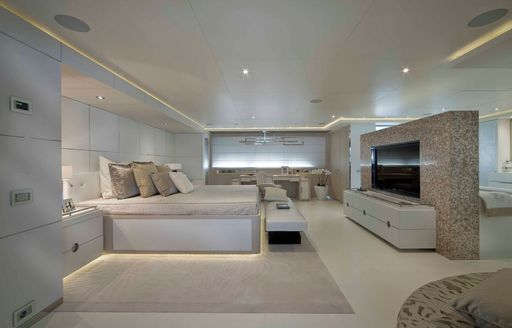 owners cabin on crn yacht light holic with large tv and bed