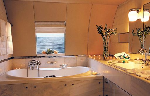 the private ensuite bathroom with beautiful view of the ocean inside the master deck of charter yacht carmen fontana