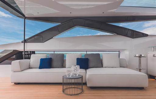 vista blue sundeck seating with ccoktail table and white sofa