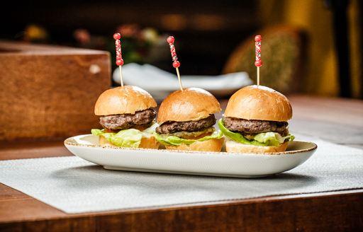 Three mini burgers on table at Iris, Abu Dhabi