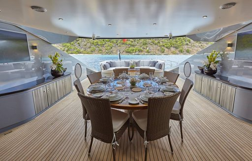 The alfresco dining table on board superyacht 'Grey Matters'