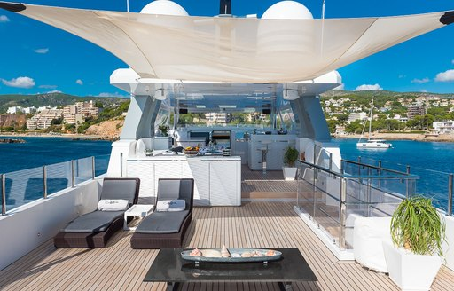 Sunlounging area covered by canva on motor yacht Cinquanta 50