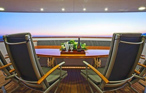 Alfresco dining on aft deck of motor yacht Axantha II