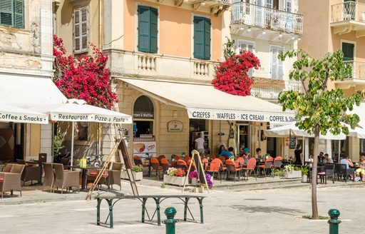 People eating in cafes on the Liston, Corfu