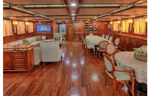 Lounge and dining areas in main salon of charter yacht Sea Dream