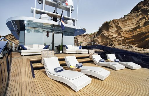 sun loungers lined up on sundeck of motor yacht BLADE