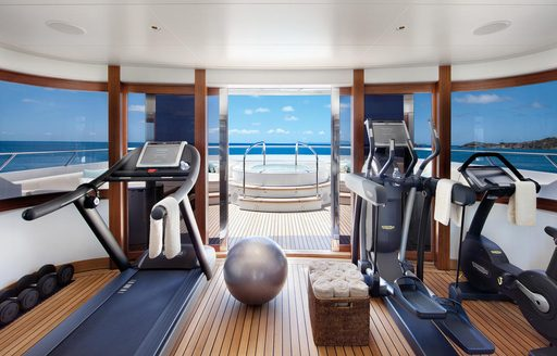 Two treadmills on opposite sides of a superyacht gymnasium