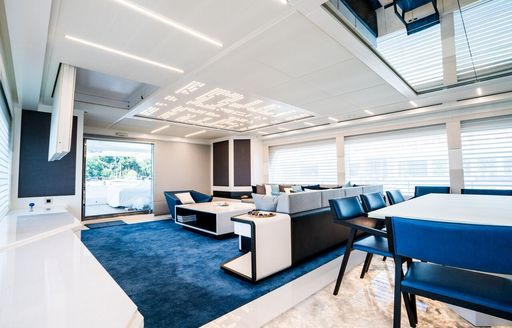 A graphic rendering illustrating the blue and white furnishings inside of superyacht SERENITAS II