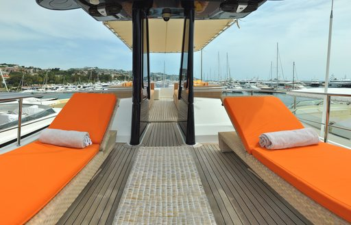 Orange sunpads on sundeck of luxury yacht CONQUISTADOR