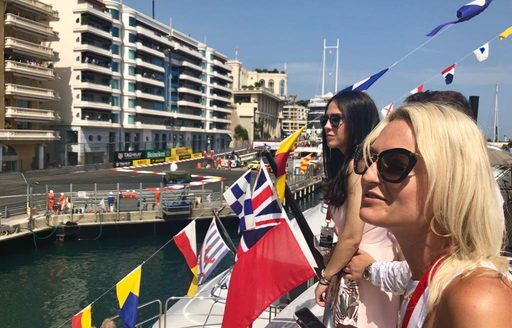 Charter guests watching the Monaco Grand Prix 2018 from the comfort of a superyacht