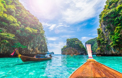 Wooden boats floating in Thailand