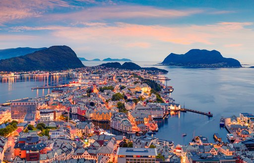 From the bird's eye view of Alesund port town on the west coast of Norway, at the entrance to the Geirangerfjord. Colorful sunset in the North.