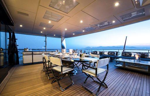 alfresco dining area on the upper deck aft of luxury yacht elixir