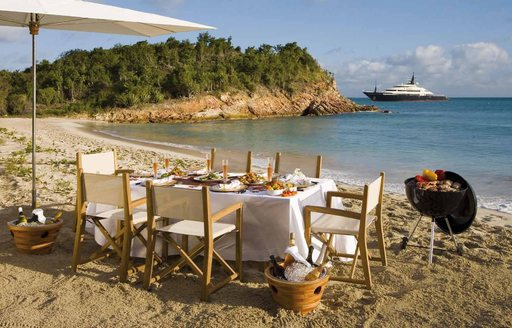 luxury yacht beach set up with umbrella and table