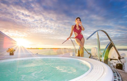 A charter guest and the Jacuzzi on board superyacht 'Mine Games'