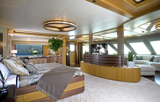 master suite with raised bed and lounge area on board charter yacht 'Indian Empress'