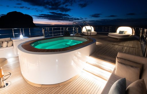 spa pool on sun deck at night of superyacht driftwood
