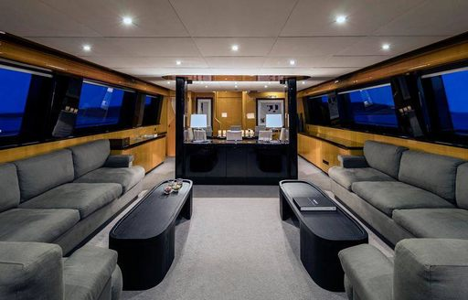 superyacht cant remember main salon with gray sofas and black coffee tables