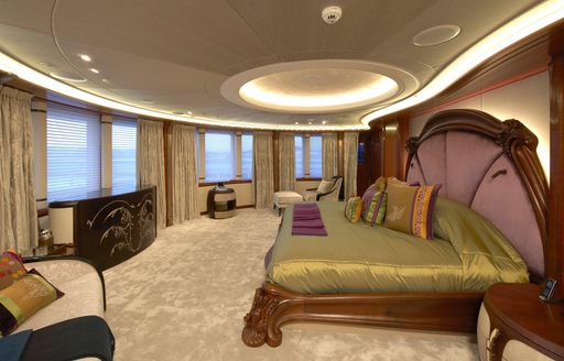 main suite on luxury superyacht with bed in centre