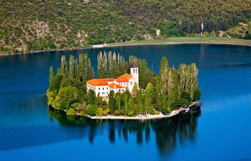 Visovac island monastery on river Krk in National Park Krk